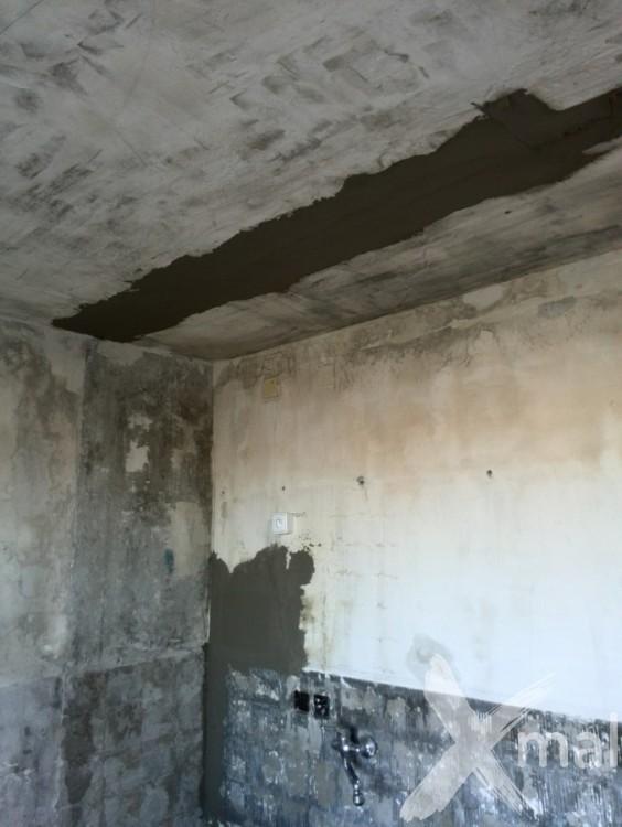 Štukování zdí kuchyňského koutu