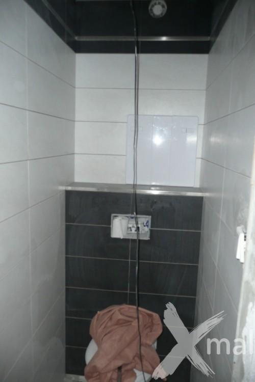 Obklady a dlažba na záchodě