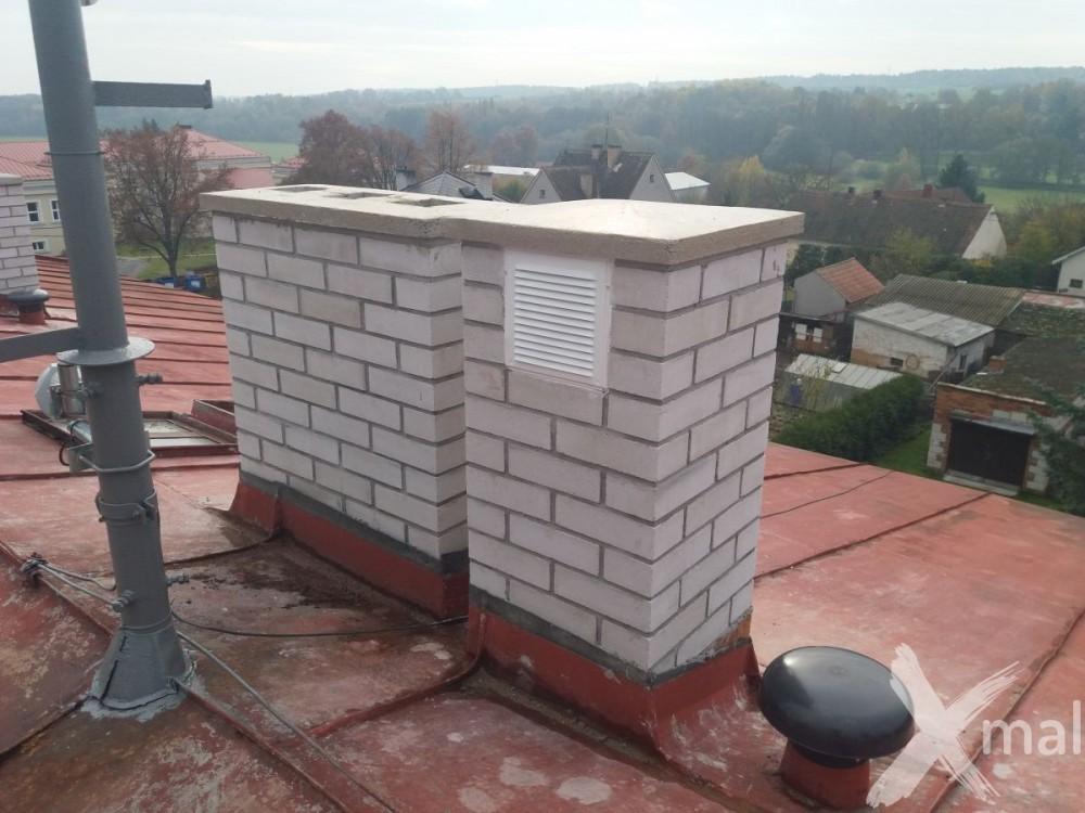 Nové komíny bytového domu po rekonstrukci