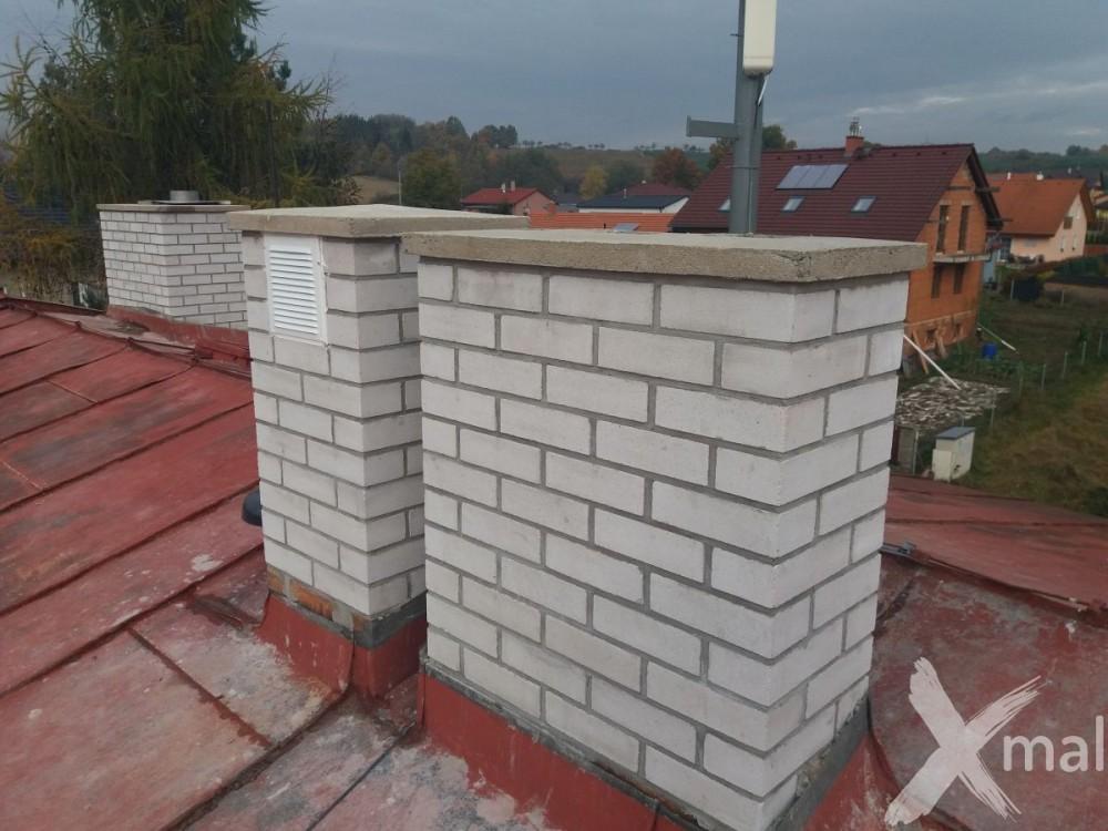Nové komíny bytového domu po rekonstrukci č1