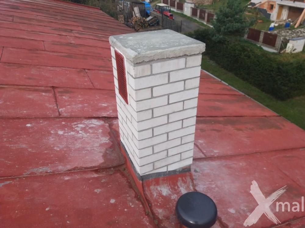 Nové komíny bytového domu po rekonstrukci č3