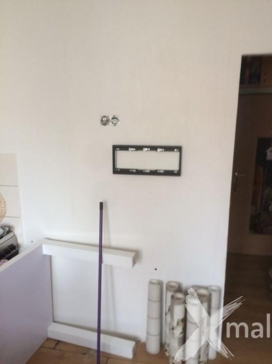 Stěna v obývacím pokoji před tapetováním